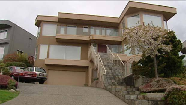 An African woman claims she was held as a virtual slave in this West Vancouver home for one year.