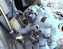 Mission specialist Drew Feustel is seen from the helmet camera of mission specialist Greg Chamitoff during the first spacewalk of Endeavour's final mission. (NASA TV)