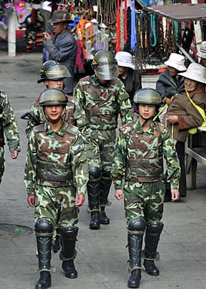 Armed Chinese paramilitary policemen patrol a street near Jokhang temple in Lhasa, Tibet on May 12, 2011. (Reuters)