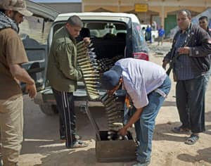 Rebel fighters load ammunition brought in a pickup at the frontline between the rebels and Moammar Gadhafi forces, 25 kilometres west of Misrata, Libya, Monday.