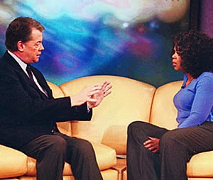 The CBC's Brian Stewart appears on Oprah's famous yellow couch in 2004.