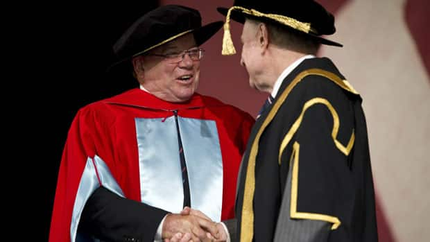 William Shatner is congratulated by chancellor Arnold Steinberg as he receives an honourary degree from McGill University, his alma mater.