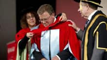 Shatner is hooded by professor Victoria Kapsi at the McGill ceremony.