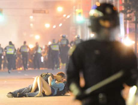 The Getty Images photo that went around the world, featuring Scott Jones trying to comfort his girlfriend Alex Thomas.