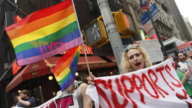Gay rights advocates chant slogans during a rally for same sex marriage ...