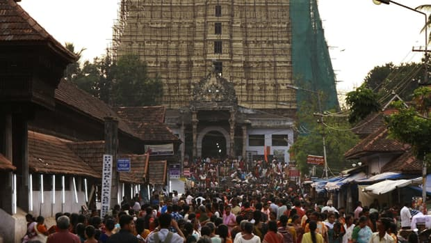 Devotees throng to Sree Padmanabhaswamy temple in February. A treasure trove of gold, diamonds and precious stones hidden for centuries has been discovered in the vaults of the underground temple.