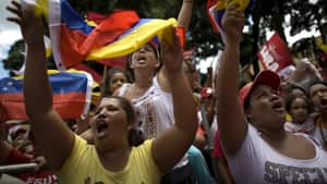Supporters of Venezuela's President Hugo Chavez chant slogans during a march in Caracas on Sunday.