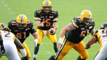 Edmonton Eskimos take on the Hamilton Tiger-Cats during a CFL game on July 9 in Edmonton. The team was forced to move its practice indoors because of the city's mosquito problem.