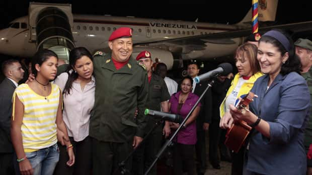 Prior to departing for Cuba, Venezuelan President Hugo Chavez, third from left, listens to a performance at Maiquetia's Airport outside Caracas Aug. 6. Chavez returned to Cuba for a second session of chemotherapy to treat a cancer that has forced him to slow his pace ahead of a re-election bid.