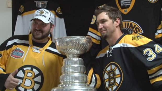 Boston Bruins defenceman Shane Hnidy (right) poses with a fan after bringing the Stanley Cup to Neepawa on Thursday.