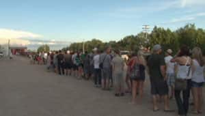 Fans form a long line outside the distant red doors of the Yellowhead Arena in Neepawa, waiting to meet Bruins defenceman Shane Hnidy and the Stanley Cup.