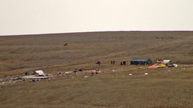 Authorities work at the scene of the First Air crash site in Resolute Bay, Nunavut. Twelve people were killed when Flight 6560 went down on Aug. 20, 2011.
