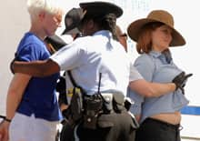 U.S. Park Police officers search women who were arrested with a group of about 40 demonstrators in front of the White House last week on the third day of protests against the Keystone XL pipeline.