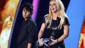 Lady Gaga looks on as Britney Spears accepts the Video Vanguard award at the MTV Video Music Awards on Sunday.