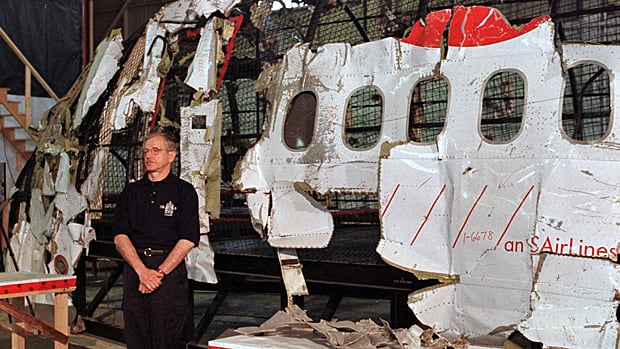 Vic Gerden, lead investigator into the crash of Swissair Flight 111 off Peggys Cove, N.S., stands in front of the plane's cockpit at the reconstruction hangar at CFB Shearwater on May 27, 1999.