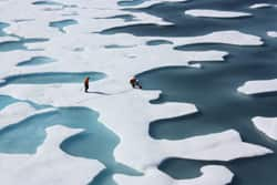 Ice melt from the surface, as shown in this July image, has now stopped. But ice continues to be melted from underneath by warmer water below.