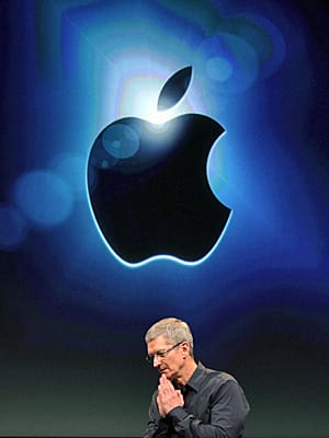 Apple CEO Tim Cook, shown unveilling the iPhone 4S this week. When Steve Jobs stepped down on Aug. 24, he handpicked Cook as his successor. Analysts will be closely watching the company's results on Oct. 18.