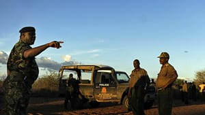 Kenyan security forces get instructions on Saturday during a search mission near Liboi, Kenya's border town with Somalia, where it is believed two Spanish aid workers kidnapped from Kenya's Dadaab refugee camp, in the company of five men of Somali appearance were last seen being marched towards the border.