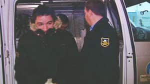 Hugues Latour is led by RCMP into a Yellowknife courtroom on Oct. 20, 2011. He faces 10 charges, including sexual assault and making and possessing of child pornography.
