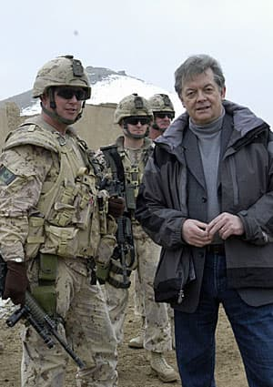 The CBC's Brian Stewart, with Canadian military trainers at a facility near Kabul in 2008. Their role has suddenly become much more dangerous.