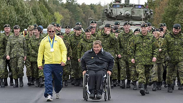 Rick Hansen and members of the Royal Canadian regiment at Cape Gagetown, N.B. in early October 2011. At his right is Mike Galey, one of the relay runners who is helping to recreate the Man in Motion tour from 1986. By November, the relay had moved West into Ontario.