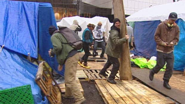 Occupy Vancouver volunteers make changes to their tent city in anticipation of a court ruling upholding changes ordered by the city's fire department.