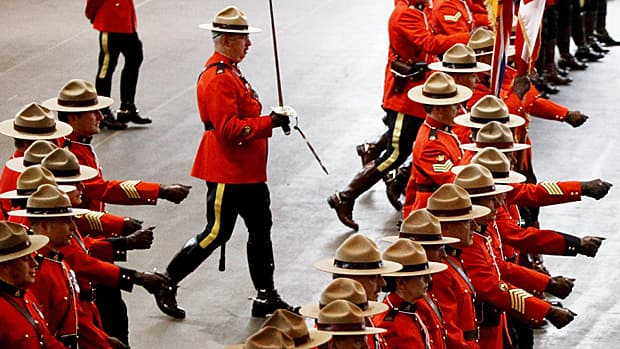 RCMP officers take up positions to form an honour guard during a change of command ceremony in Vancouver on Feb. 11, 2011.