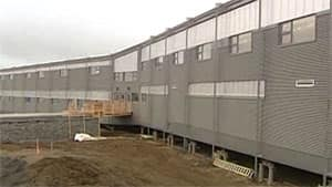 The architects who designed the new, not-yet-finished, school in Inuvik, N.W.T., used pipes frozen 20 metres into the ground as part of the building's foundation. The pipes are meant to keep the school's foundation stable.