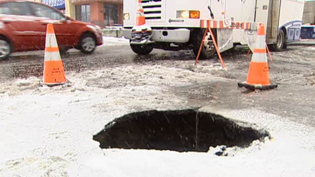 Police closed off the intersection after the sinkhole formed Wednesday morning.