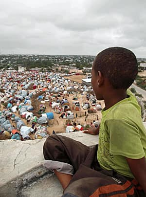 A Somalian boy looks out over the Seyidka settlement for the famine stricken near the capital Mogadishu in September 2011.