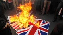 Protesters burn a British flag taken down from the British embassy in Tehran on Nov. 29, 2011.