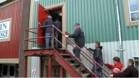 Some of the employees of Ocean Choice International in Marystown swarmed into their idled fish plant on Friday afternoon denouncing OCI's decision to shut down the plant.