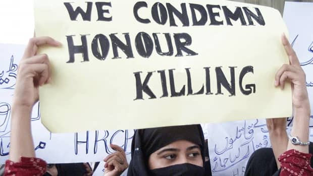A Pakistani woman holds a placard during a protest against honour killing in Multan on Oct. 27, 2004. Pakistan passed a bill making the death penalty the maximum punishment for those convicted of killing a person in the name of family honour, but so-called honour killings still go on not just in Pakistan but in some religious and ethnic communities in Canada as well.