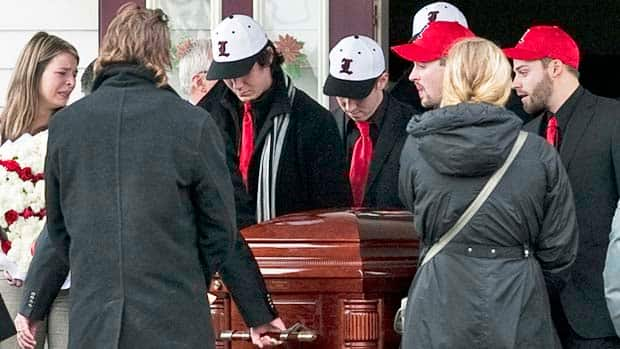 Members of the Lethbridge Bulls baseball team carry the casket of teammate ...