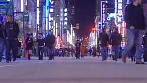 Pedestrians walk along Vancouver's Granville Street during a temporay closure to turn it into a pedestrian mall.