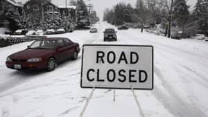 Vehicles ignore a road closure in Kirkland, Wa., during a snowstorm on Jan. 18, 2012.
