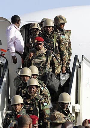African Union soldiers disembark, in January 2012, in Mogadishu, the beseiged capital, for their mission against al-Shabaab, which controls most of the surrounding area.