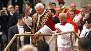 Pope Benedict XVI waves as he arrives to preside over a consistory in St. Peter's basilica at the Vatican.