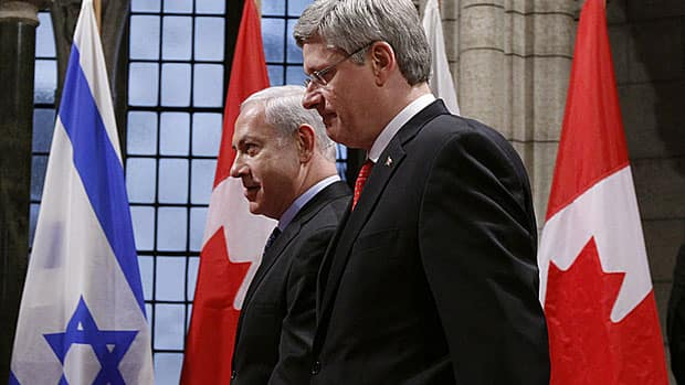 Prime Minister Stephen Harper, right, walks with Israeli Prime Minister Benjamin Netanyahu on Parliament Hill Friday. The two leaders were discussing growing tensions with Iran over its nuclear program.