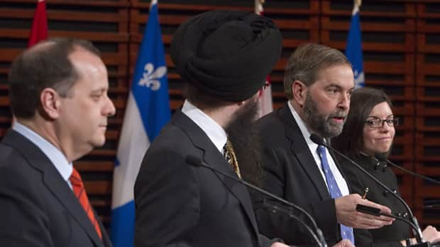 NDP federal leadership candidate Thomas Mulcair, second from right, responds to a question during an NDP leadership debate last month as fellow candidates Brian Topp, far left, Martin Singh, second from left, and Niki Ashton, right, look on.