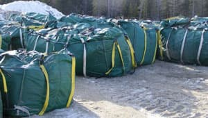Industrial-sized waste bags containing asbestos and contaminated soil have been dropped off at the Gillam dump.