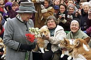 Queen Elizabeth talks with members of the Manitoba Corgi Association during a visit to Winnipeg on Oct. 2, 2002.