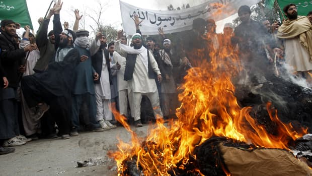 Afghans burn an effigy of U.S. President Barack Obama during a Tuesday demonstration in Jalalabad province, against Sunday's shooting of at least 16 villagers by a U.S. Army staff sergeant in the volatile Afghan province of Kandahar.
