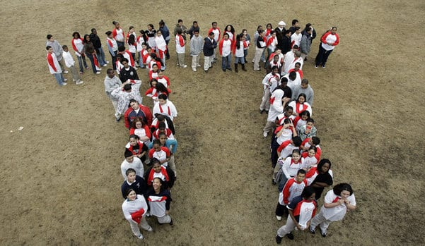 Students from Maurice J. Tobin School in Boston make a human π symbol during a celebration of Pi Day, an unofficial holiday in the math community observed each year on the 14th of March.