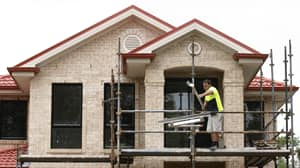 A man works on a house in Sydney. Australia put the brakes on foreign ownership of real estate in 2010 after speculation drove up housing prices in Sydney and other major cities.