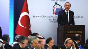 Turkish PM Recep Tayyip Erdogan, right, told Sunday's session of the Friends of the Syrian People conference in Istanbul that military options should remain on the table for stemming the violence in Syria.