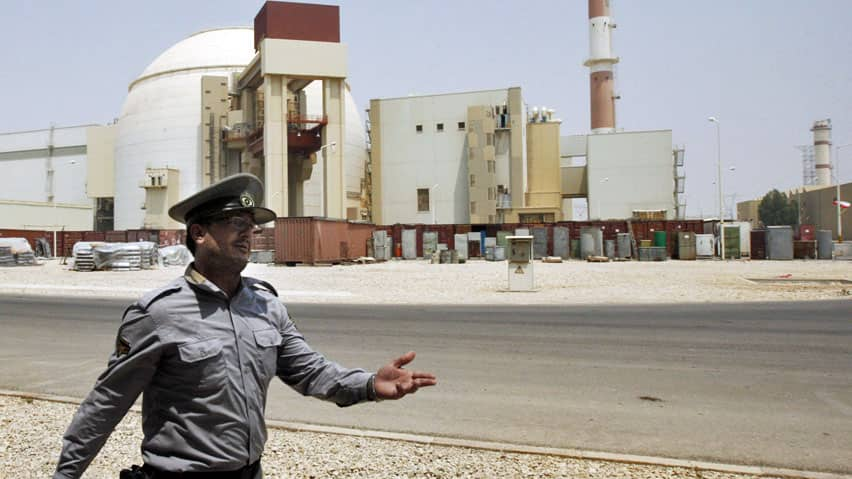A security officer directs media at the Bushehr nuclear power plant in the southern city of Bushehr, Iran. Talks are scheduled to begin between Iran and the West, more than 14 months after the previous round collapsed.
