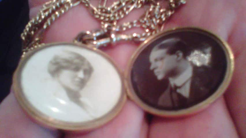 Mike Radcliffe holds a gold locket with photographs of his great-aunt Adelaide, left, and her husband Charles Sedgwick, who died when the Titanic sank in 1912.