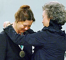 Former governor general Adrienne Clarkson presents Marilou McPhedran with a medal in 2003 commemorating the Person's Case, an award that salutes the contribution of women to the advancement of women's equality.