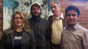 Start-up Weekend organizer Cheryl Draper with (from left) mentor Scott Annan and participants James Newton and Abdul Hassab.